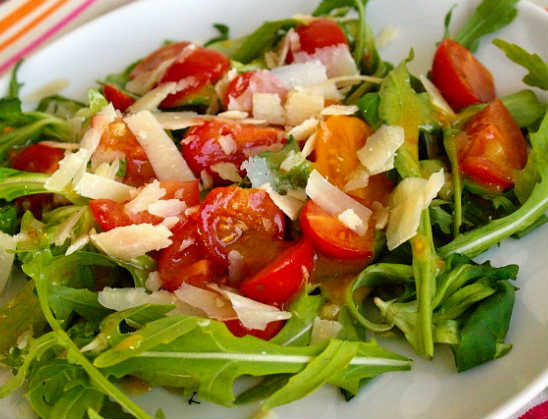 Spicy salad with cherry tomatoes and chees photo